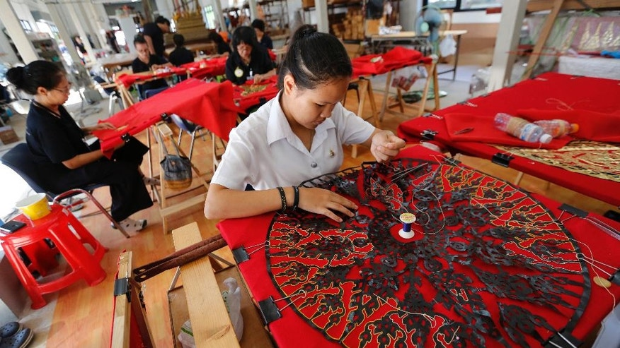 Women embroider intricate patterns to decorate the royal crematorium for the late Thai King Bhumibol Adulyadej at the Office of Traditional Arts in Nakhon Pathom province, Thailand, Thursday, April 20, 2017. The cremation is planned for late October, 2017. (AP Photo/Sakchai Lalit)