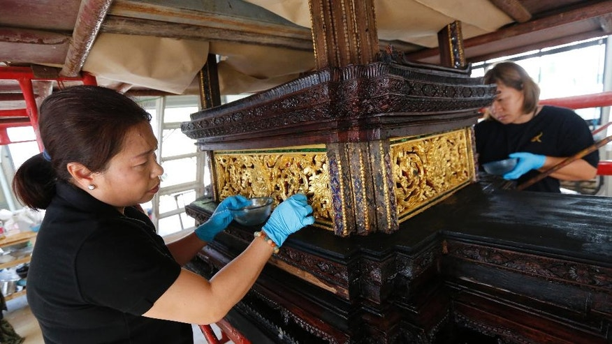 Artisans clean the royal funeral chariot to be used as part of the cremation for the late Thai King Bhumibol Adulyadej at the Office of Traditional Arts Nakhon Pathom province, Thailand, Thursday, April 20, 2017. The cremation is planned for late October, 2017. (AP Photo/Sakchai Lalit)