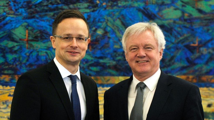 British Secretary of State for Exiting the European Union David Davis, right, and Hungarian Minister of Foreign Affairs and Trade Peter Szijjarto meet at the Ministry of Foreign Affairs and Trade in Budapest, Hungary, Thursday, April 20, 2017. (Attila Kovacs/MTI via AP)