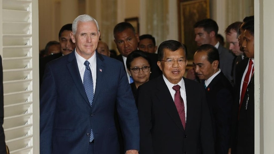 U.S. Vice President Mike Pence, left, walks with his Indonesian counterpart Jusuf Kalla, right, after their meeting in Jakarta, Indonesia, Thursday, April 20, 2017. Indonesia is the latest stop on an Asian tour by Pence that is reinforcing traditional U.S. alliances at a time when Donald Trump's presidency has raised questions about the strength of the U.S. commitment to the region. (AP Photo/Achmad Ibrahim, Pool)