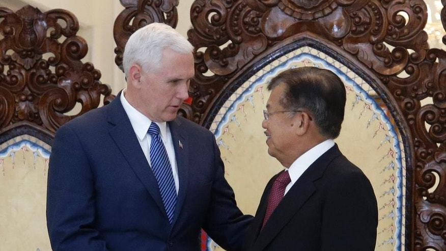 U.S. Vice President Mike Pence, left, shakes hands with his Indonesian counterpart Jusuf Kalla during their meeting in Jakarta, Indonesia, Thursday, April 20, 2017. Indonesia is the latest stop on an Asian tour by Pence that is reinforcing traditional U.S. alliances at a time when Donald Trump's presidency has raised questions about the strength of the U.S. commitment to the region. (AP Photo/Achmad Ibrahim, Pool)