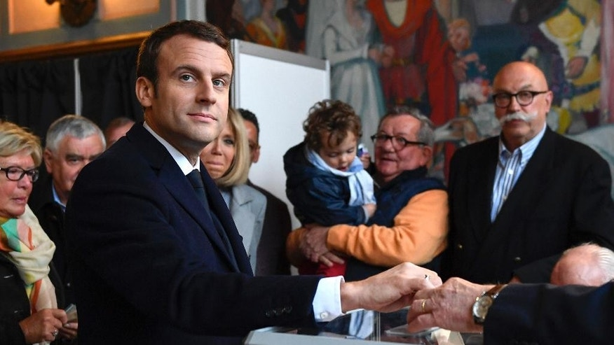 French centrist presidential election candidate Emmanuel Macron casts his ballot for the first round of the presidential election in Le Touquet, northern France, Sunday April 23, 2017. (Eric Feferberg, Pool photo via AP)
