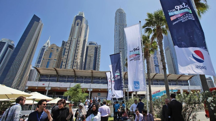 In this Wednesday, April 5, 2017, photo, young entrepreneurs mostly from all over the Middle East visit the Step 2017 Conference and Music in Dubai, United Arab Emirates. A mobile app to track school buses, Arabic cooking videos on YouTube and even a portable bideu are finding support from governments in the Gulf as a slide in oil prices forces states to cull cushy public sector jobs and look to entrepreneurs to plug the gap. (AP Photo/Kamran Jebreili)