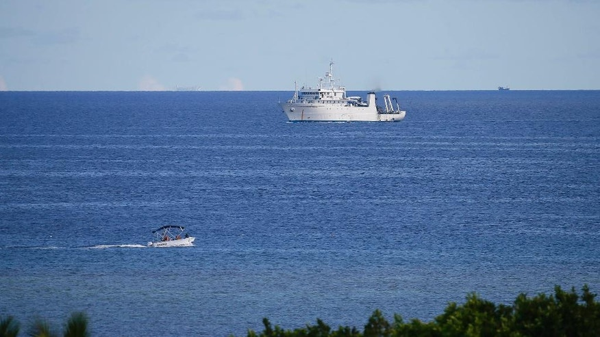 Philippine research vessels are seen in the vicinity of the Philippine-claimed Thitu island during the visit of Defense Secretary Delfin Lorenzana and other officials off the disputed South China Sea,  Friday, April 21, 2017. Philippine Defense Secretray Delfin Lorenzana, Armed Forces Chief Gen. Eduardo Ano and other officials flew to Thitu Island Friday to assert the country's claim to the heartland of a disputed area where China is believed to have added missiles on man-made islands. The South China Sea issue is expected to be discussed in the 20th ASEAN Summit of Leaders next week.(AP Photo/Bullit Marquez)