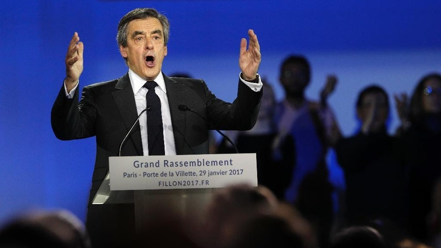 FILE - In this Jan. 29, 2017 file photo, French Conservative presidential candidate Francois Fillon makes a speech during a campaign meeting in Paris. Conservative candidate Francois Fillon is struggling to keep his chances in the presidential election despite a personal image damaged by corruption allegations. Once a front-runner in the race, Fillon's campaign has been flailing since the investigation began in January. (AP Photo/Christophe Ena, File)