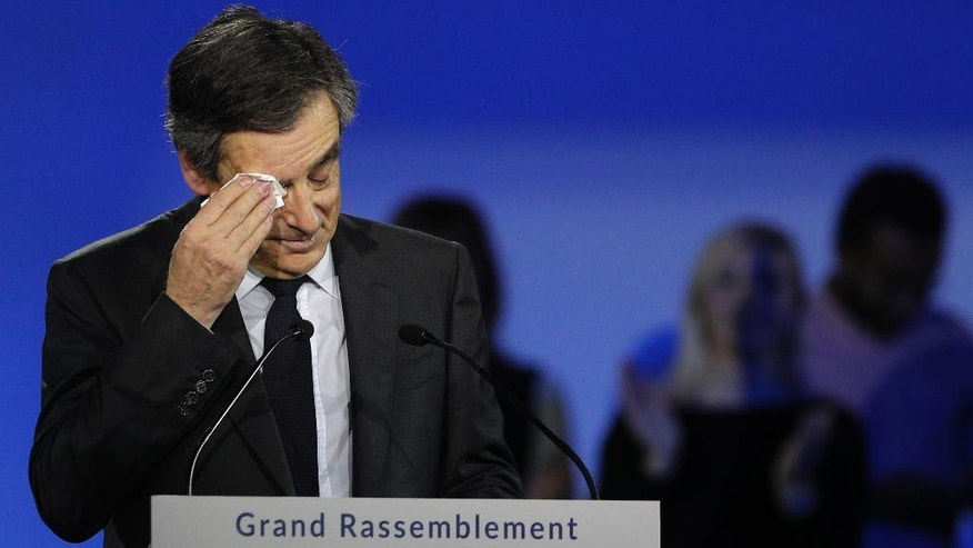 FILE - In this Jan. 29, 2017 file photo, French Conservative presidential candidate Francois Fillon wipes his forehead during a campaign meeting in Paris. Conservative candidate Francois Fillon is struggling to keep his chances in the presidential election despite a personal image damaged by corruption allegations. Once a front-runner in the race, Fillon's campaign has been flailing since the investigation began in January. (AP Photo/Christophe Ena, File)