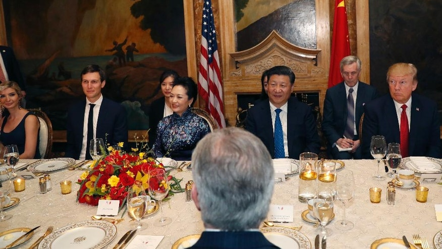 FILE - In this Thursday, April 6, 2017, file photo, U.S. President Donald Trump and Chinese President Xi Jinping, with their wives, first lady Melania Trump and Chinese first lady Peng Liyuan, are seated during a dinner at Mar-a-Lago, in Palm Beach, Fla. Ivanka Trump, the daughter and assistant to President Donald Trump, and White House senior adviser Jared Kushner are seated at left. Ivanka Trump's work on behalf of her brand in China intensified as her father closed in on the Republican nomination for U.S. president, with her company applying for nearly twice as many trademarks in a five-month span as it had in the preceding eight years. (AP Photo/Alex Brandon, File)