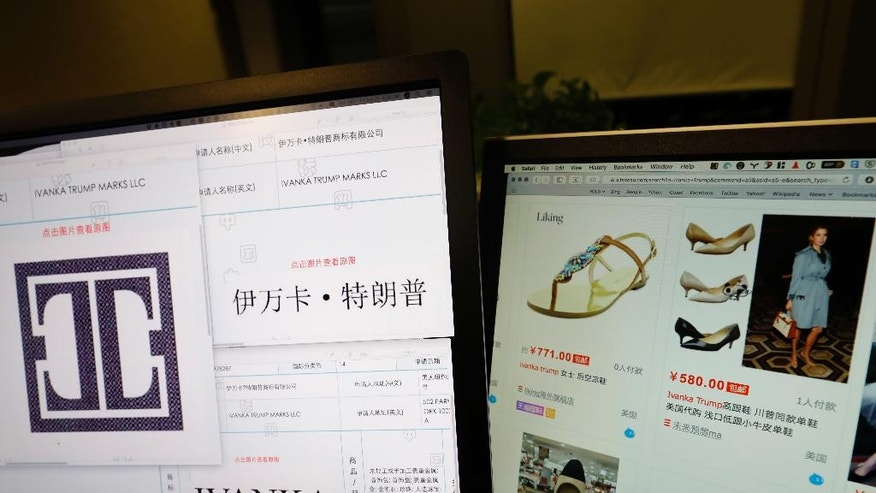 Trademark applications from Ivanka Trump Marks LLC images taken off the website of China's trademark database are displayed next to a Chinese online shopping website selling purported Ivanka Trump branded footwear on computer screens in Beijing, China, Friday, April 21, 2017. Ivanka Trump's work on behalf of her brand in China intensified as her father closed in on the Republican nomination for U.S. president, with her company applying for nearly twice as many trademarks in a five-month span as it had in the preceding eight years. (AP Photo/Ng Han Guan)