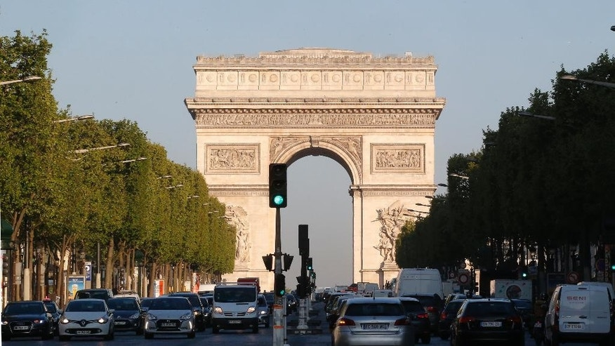 The Arc de Triomphe is pictured on the Champs Elysees boulevard in Paris, early Friday, April 21, 2017. Paris' iconic Champs-Elysees boulevard is reopen and picking up its usual early morning routine Friday after a gunman opened fire on police, killing one officer and wounding three people before police shot and killed him.(AP Photo/Michel Euler)