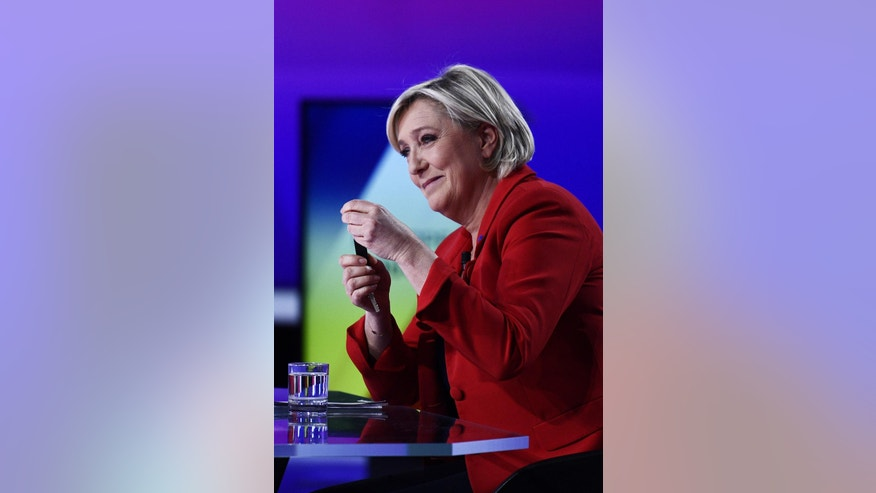 Far-right leader and candidate for the 2017 French presidential election Marine Le Pen attends a television debate at French national television France 2, in Saint Cloud, outside Paris, Thursday, April 20, 2017. The 11 men and women hoping to be France's next president are to appear on national television in a last appeal to voters in a nail-biting election campaign. (Martin Bureau/Pool via AP)