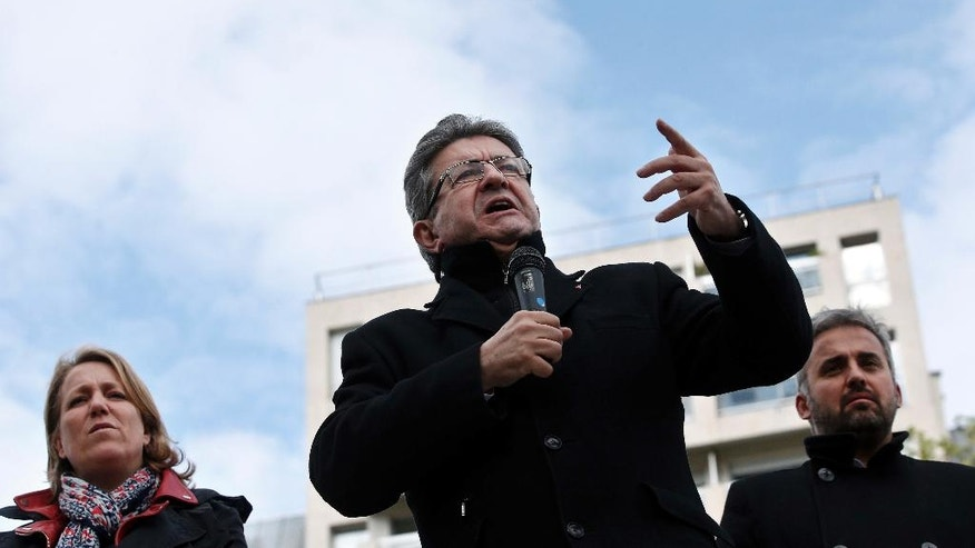 French Left party leader and candidate for the 2017 French presidential election, Jean-Luc Melenchon gives a speech from a barge on the canal de l'Ourcq, in Paris, Monday, April 17, 2017. Melenchon has risen in polls ahead of the first round of France's presidential election on April 23, with some pollsters saying he could have a chance of reaching the May 7 presidential runoff.  (AP Photo/Thibault Camus)