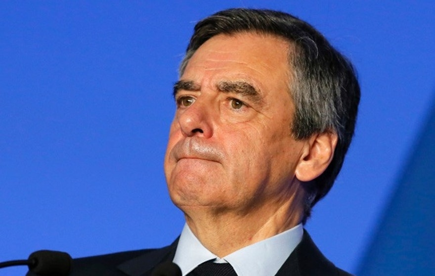 FILE - In this Monday, March 13, 2017 file photo, French conservative presidential candidate Francois Fillon presents his program in Paris. Fillon has been given preliminary charges in an investigation into taxpayer-funded jobs for his wife and children they allegedly never performed.y Tuesday March 14, 2017 (AP Photo/Francois Mori, File)