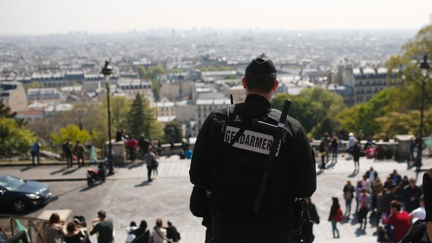 A gendarme patrols in the Montmartre district Friday, April 21, 2017 in Paris. The shooting at the Champs Elysees rattled France only two days before the end of an unusually suspenseful election contest. (AP Photo/Kamil Zihnioglu)