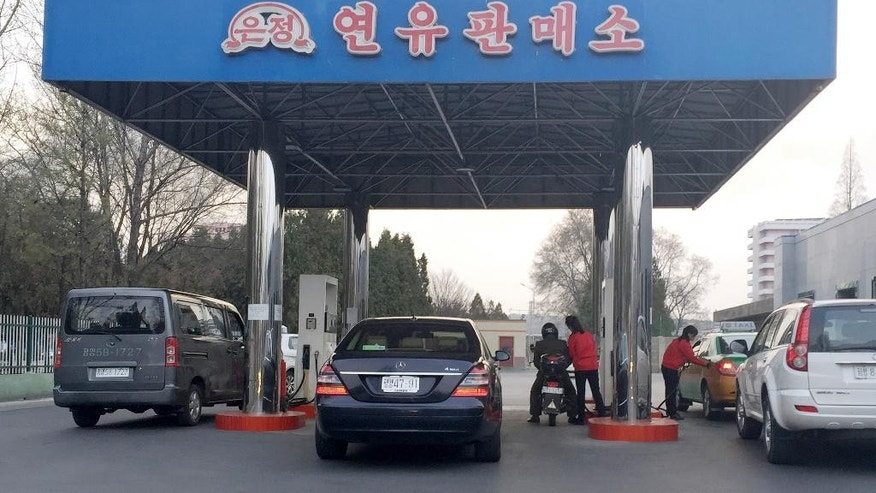 FILE - In this April 1, 2016, photo, cars line up at at a gas station in Pyongyang, North Korea. Car users in Pyongyang are scrambling to fill up their tanks as gas stations limit services and close their gates amid concerns of a possible shortage. The cause of the restrictions or how long they might last were not immediately known. (AP Photo/Eric Talmadge, File)