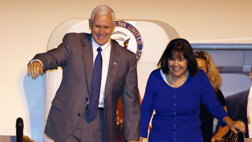 U.S. Vice President Mike Pence, left, and his wife Karen smile as they arrive in Sydney, Friday, April 21, 2017. Pence will meet with Australian Prime Minister Malcolm Turnbull on Saturday as part of his 10-day, four country trip to Asia. (AP Photo/Rick Rycroft)