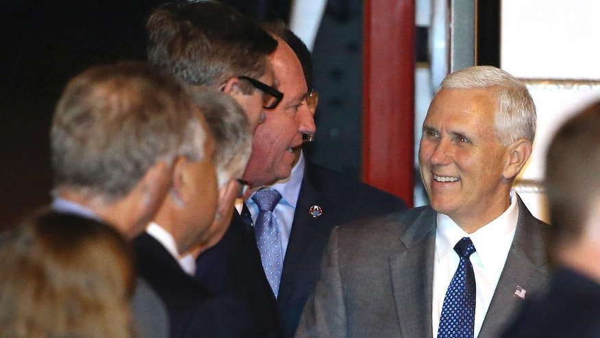U.S. Vice President Mike Pence, right, is greeted by Australian Deputy Prime Minister Barnaby Joyce after arriving in Sydney, Friday, April 21, 2017. Pence will meet with Australian Prime Minister Malcolm Turnbull on Saturday as part of his 10-day, four country trip to Asia. (AP Photo/Rick Rycroft)