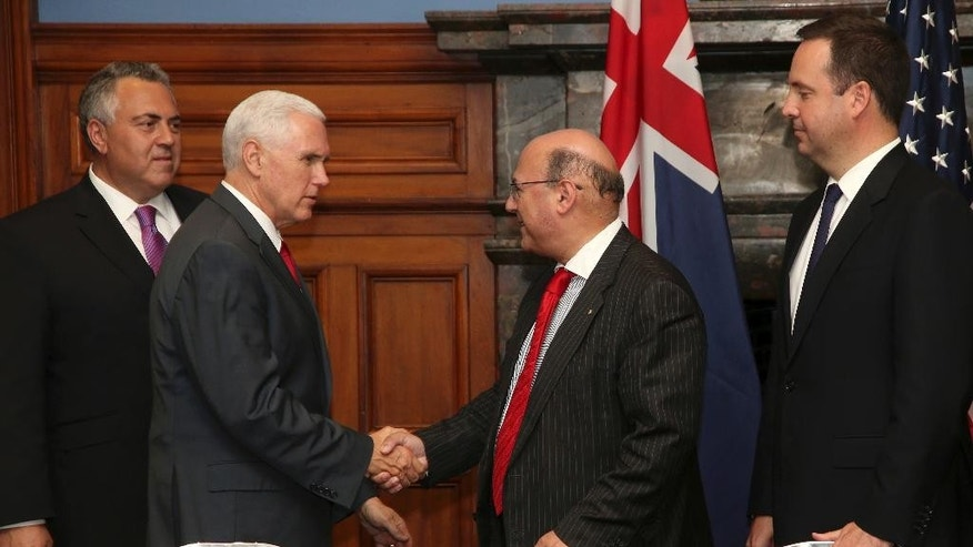 U.S. Vice President Mike Pence, second left, meets Australian Minister for Industry, Arthur Sinodinos Australian Minister for Industry as Steven Ciobo, right, Australian Minister for Trade and Joe Hockey, Australian Ambassador to the U.S. look on while attending a business listening session with Australian and U.S. companies in Sydney, Saturday, April 22, 2017. Pence is on the last leg of his 10-day visit to Australia and Asia. (AP Photo/Rick Rycroft, Pool)