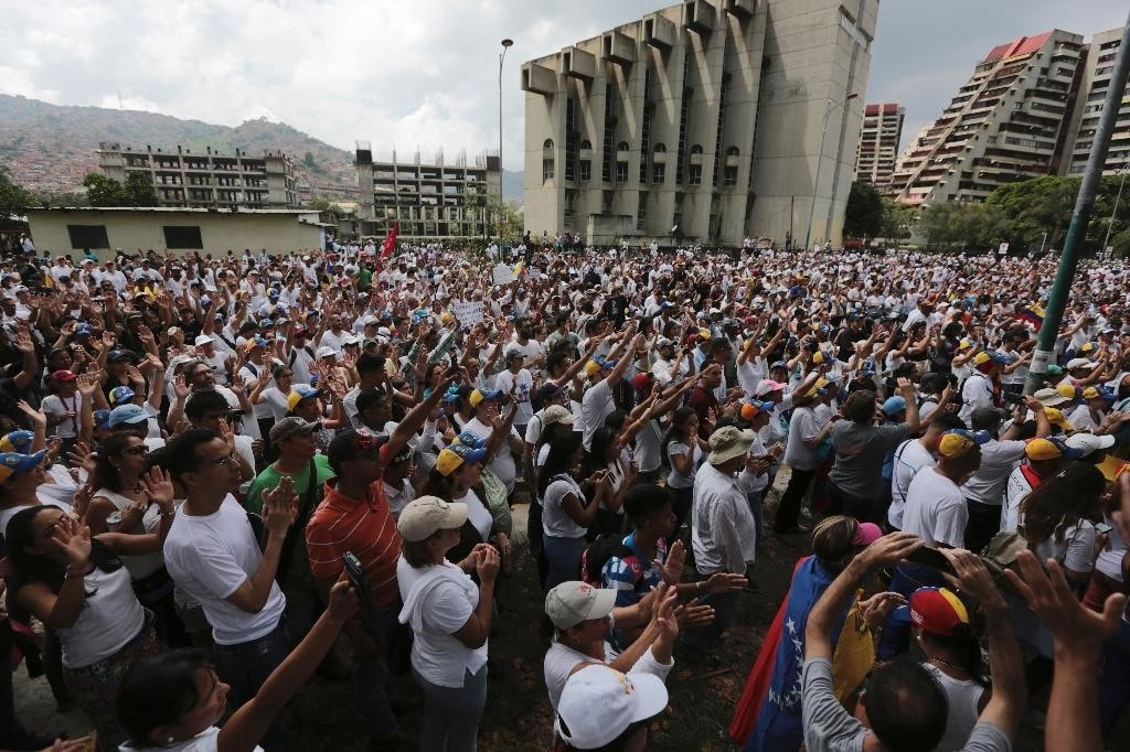 The Latest: Venezuelan protesters cross into western Caracas