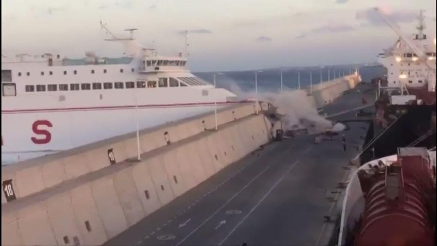 "This image taken from video shows a Naviera Armas ferry hitting the breakwater at Puerta de la Luz, Gran Canaria, Spain on Friday, April 21, 2017. Thirteen ferry passengers were injured when the boat slammed into a breakwater in a port on the Canary Islands, Spanish authorities said Saturday. Manolo Vidal, spokesman for Naviera Armas, the company that owns the ferry, says that a ""loss of electrical power"" caused the accident as the boat was leaving the Puerta de la Luz on the island of Gran Canaria Friday night. (EMERGCAN via AP)"