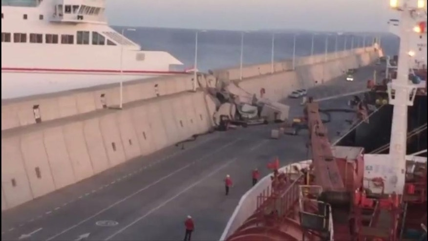 "This image taken from video shows a Naviera Armas ferry after hitting the breakwater at Puerta de la Luz, Gran Canaria, Spain on Friday, April 21, 2017. Thirteen ferry passengers were injured when the boat slammed into a breakwater in a port on the Canary Islands, Spanish authorities said Saturday. Manolo Vidal, spokesman for Naviera Armas, the company that owns the ferry, says that a ""loss of electrical power"" caused the accident as the boat was leaving the Puerta de la Luz on the island of Gran Canaria Friday night. (EMERGCAN via AP)"