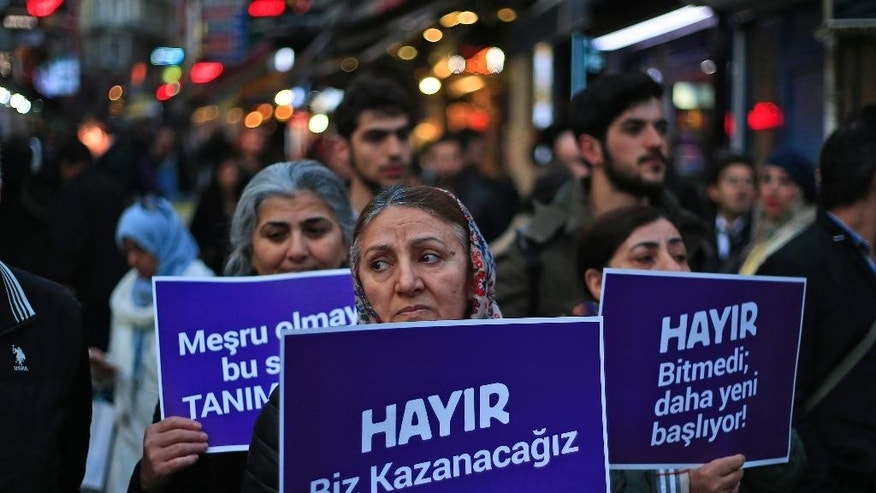 "Supporters of the 'NO' vote, ( ""Hayir"" in Turkish) participate in a protest against the referendum outcome, in Istanbul, Friday, April 21, 2017. The placard centre reads in Turkish: 'NO, we will win' and the one right, reads: 'NO, it is not over, it has just started'. Turkey's opposition party is contesting the results of April 16 referendum over a number of irregularities, in particular an electoral board decision to accept ballots without official stamps, as required by Turkish law. (AP Photo/Lefteris Pitarakis)"