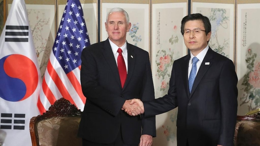 FILE - In this April 17, 2017, file photo Vice President Mike Pence, left, poses with South Korea's acting President and Prime Minister Hwang Kyo-ahn for a photo before their meeting in Seoul, South Korea. Vice President Mike Pence's 10-day, four nation visit to Asia has offered evidence that Pence is becoming one of President Donald Trump's main emissaries on the global stage, patching up relations, reassuring allies who wonder about Trump's unpredictable ways and diving into international crises like North Korea. (AP Photo/Lee Jin-man, File)