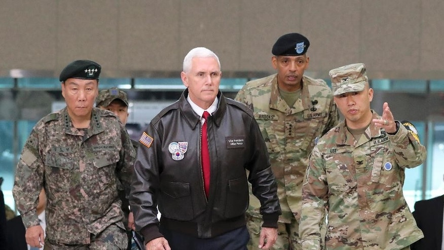 FILE - In this April 17, 2017 file photo  Vice President Mike Pence arrives with U.S. Gen. Vincent Brooks, second from right, commander of the United Nations Command, U.S. Forces Korea and Combined Forces Command, and South Korean Deputy Commander of the Combined Force Command Gen. Leem Ho-young, left, at the border village of Panmunjom in the Demilitarized Zone (DMZ) which has separated the two Koreas since the Korean War, South Korea, Monday, April 17, 2017. Vice President Mike Pence's 10-day, four nation visit to Asia has offered evidence that Pence is becoming one of Trump's main emissaries on the global stage, patching up relations, reassuring allies who wonder about Trump's unpredictable ways and diving into international crises like North Korea.  (AP Photo/Lee Jin-man, File)
