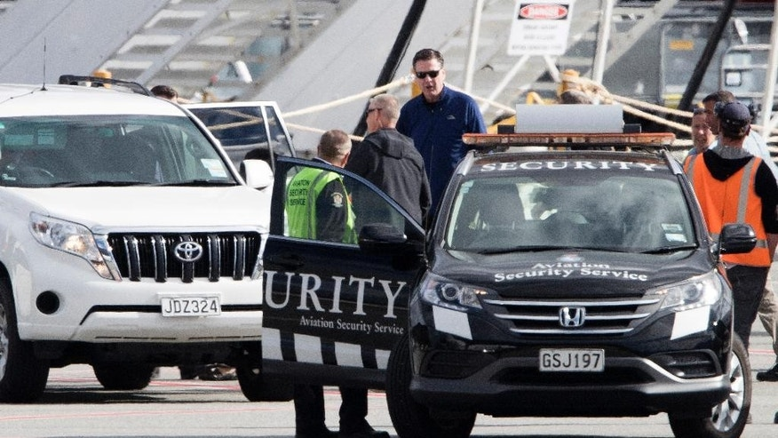 "FBI Director James Comey, center top, walks to a vehicle on the tarmac upon his arrival in Queenstown, New Zealand, Sunday, April 23, 2017. A spokeswoman for New Zealand Prime Minister Bill English said New Zealand's government is hosting a conference this week with a number of senior officials from overseas, but that she couldn't comment further ""due to specific security requirements."" A spokeswoman for the U.S. Embassy in Wellington said U.S. officials routinely attend meetings with their New Zealand counterparts ""but I can't provide further details."" New Zealand is part of the ""Five Eyes"" intelligence-sharing network, which also includes the U.S., Canada, Britain and Australia. (Brett Phibbs/New Zealand Herald via AP)"