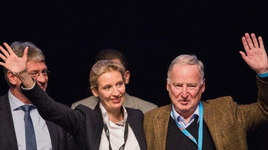 Alice Weidel, left, and Alexander Gauland, members of the AfD (Alternative for Germany) wave to the delegates during the party convention in Cologne, Germany, Sunday, April 23, 2017. The delegates elected Weidel and Gauland as new top candidates for the September general election on Sunday, after the party's best-known politician, Frauke Petry, said she would no longer be available. (Rolf Vennenbernd//dpa via AP)