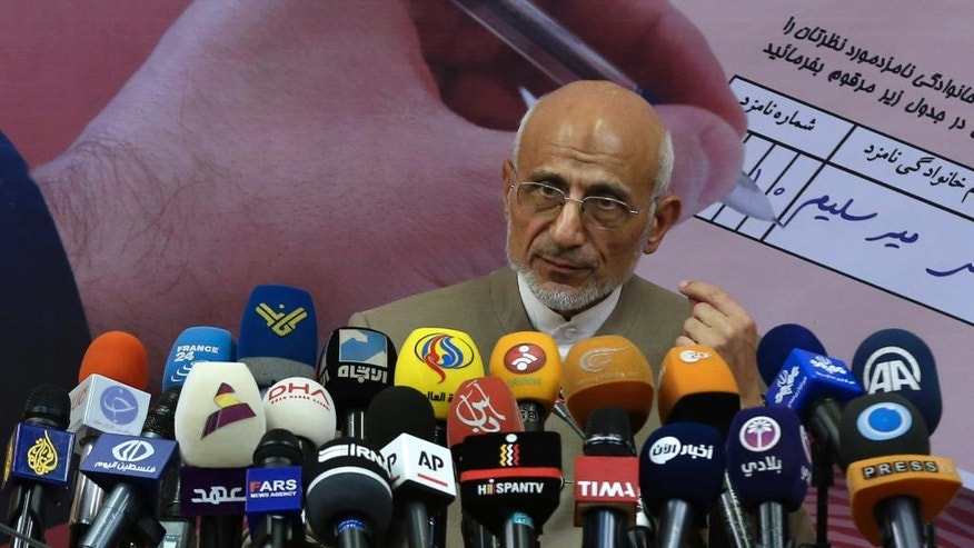 Conservative Iranian presidential candidate Mostafa Mirsalim speaks in a news conference in Tehran, Iran, Sunday, April 23, 2017. (AP Photo/Vahid Salemi)