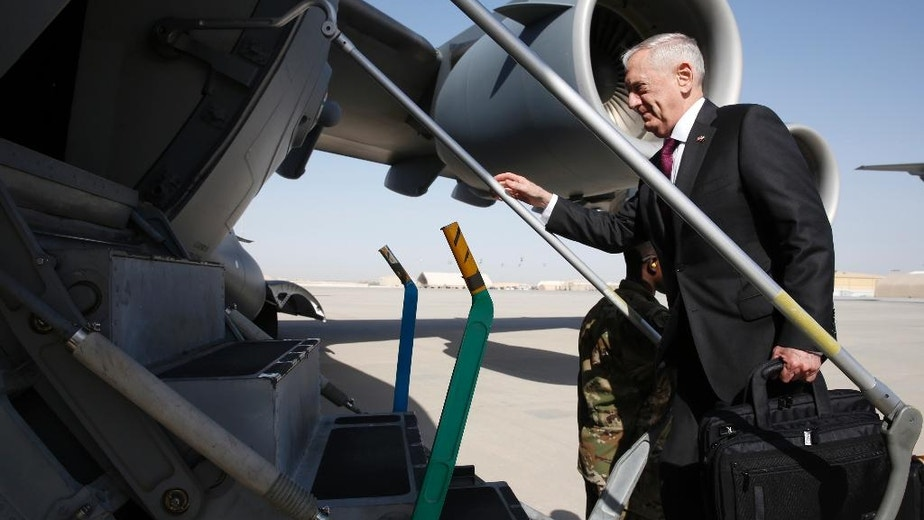 U.S. Defense Secretary James Mattis boards a U.S. Air Force C-17 Globemaster for a day trip to a U.S. military base in Djibouti from Doha, Qatar, Sunday, April 23, 2017. (Jonathan Ernst/Pool Photo via AP)
