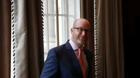 UK Independence Party leader Paul Nuttall poses for photographs before his party's policy announcement press conference for Britain's upcoming general election at a hotel in London, Monday, April 24, 2017. (AP Photo/Matt Dunham)