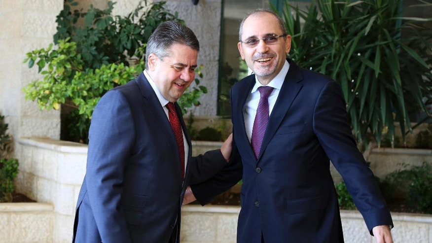 German Foreign Minister Sigmar Gabriel, left, and Jordanian Foreign Minister Ayman Safadi, meet in Amman, Jordan, Monday, April 24, 2017. (AP Photo/Raad Adayleh)