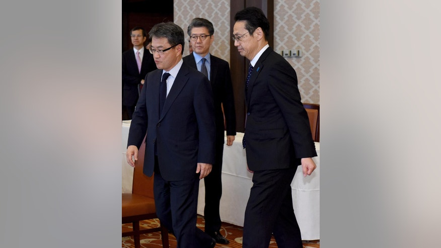 Chief nuclear negotiators, Joseph Yun, U.S. special representative for North Korea policy,  left, Kenji Kanasugi, director general of the Japanese Foreign Ministry's Asian and Oceanian Affairs Bureau, right, and Kim Hong-kyun, special representative for Korean Peninsula peace and security affairs at the South Korean Foreign Ministry, rear, arrive fir their meeting about North Korean issues at the Iikura Guesthouse in Tokyo Tuesday, April 25, 2017. North Korea marks the founding anniversary of its military on Tuesday, and South Korea and its allies are bracing for the possibility that it could conduct another nuclear test or launch an intercontinental ballistic missile for the first time.  (Toru Yamanaka/Pool Photo via AP)