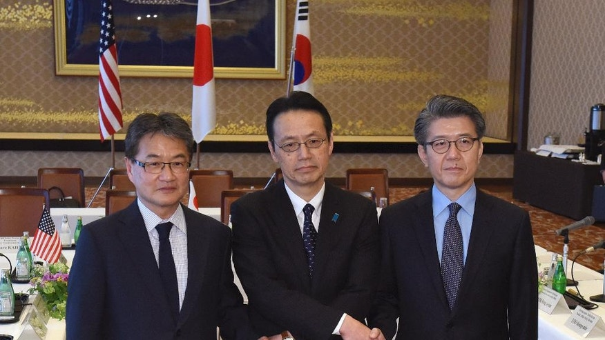 Chief nuclear negotiators from left to right, Joseph Yun, U.S. special representative for North Korea policy,  Kenji Kanasugi, director general of the Japanese Foreign Ministry's Asian and Oceanian Affairs Bureau, and Kim Hong-kyun, special representative for Korean Peninsula peace and security affairs at the South Korean Foreign Ministry, pose for photographers before their meeting about North Korean issues at the Iikura Guesthouse in Tokyo Tuesday, April 25, 2017. North Korea marks the founding anniversary of its military on Tuesday, and South Korea and its allies are bracing for the possibility that it could conduct another nuclear test or launch an intercontinental ballistic missile for the first time.  (Toru Yamanaka/Pool Photo via AP)