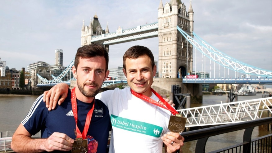 Matthew Rees helped David Wyeth cross the finish line at the London Marathon on Sunday.