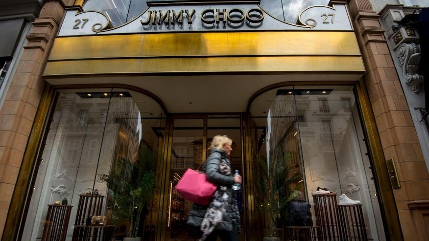 "A general view of the Jimmy Choo shop on New Bond Street, London, Monday, April 24, 2017. Shares in Jimmy Choo have leapt 11 percent after its board put the luxury shoe brand up for sale. The gains bring the market value of the firm that began in east London to over 700 million pounds ($896 million). The firm, which counts Jennifer Lopez, the Duchess of Cambridge and Beyonce among its fans, is being sold to ""maximize value for its shareholders."" (Lauren Hurley/PA via AP)"