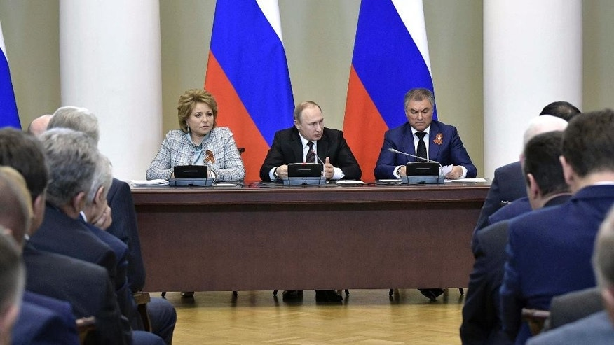 Russian President Vladimir Putin, center, speaks at a meeting with the leadership of the Russian parliament in St. Petersburg, Russia, Monday, April 24, 2017. At right back is State Duma, parliament's lower house, speaker Vyacheslav Volodin. At left back is parliament's upper house speaker Valentina Matviyenko. (Alexei Nikolsky/Sputnik, Kremlin Pool Photo via AP)