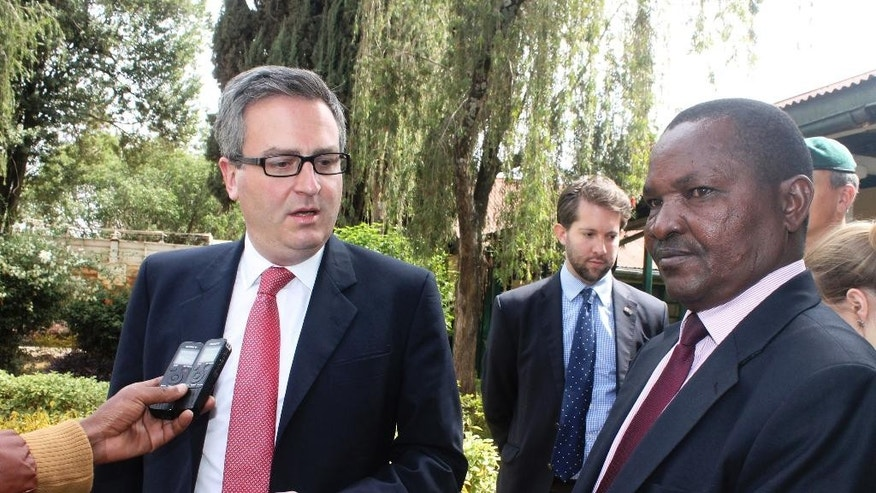 British High Commissioner Nic Hailey, left addresses the media, with Laikipia County commissioner Onesmus Musyoki, right, in Nanyuki, Kenya, Monday, April 24, 2017, after the envoy met the security team, a day after renowned international conservationist Kuki Gallman was shot and injured at her ranch on Sunday morning. Two suspects were killed after the shooting of author and conservationist Kuki Gallmann in tensions with herders seeking pasture amid the country's drought, Kenya's Internal Security Minister Joseph Nkaissery said Monday. (AP Photo/Eliud Waithaka)