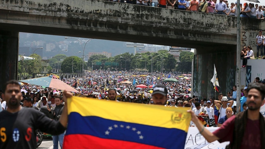 Anti-government protesters block a highway in Caracas, Venezuela, Monday, April 24, 2017.