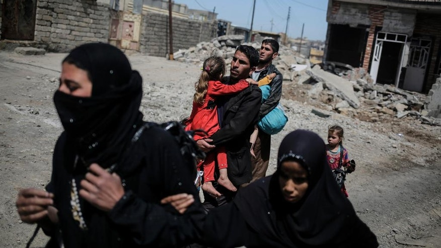 Mosul residents flee their homes as Iraqi forces battle the Islamic State group in a street to street fight in west Mosul, Monday, April 24, 2017. (AP Photo/Bram Janssen)