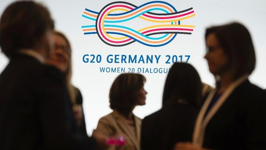 Participants speak before the opening of the Woman 20 Dialogue summit for the empowerment of women in Berlin, Germany, Tuesday, April 25, 2017. Ivanka Trump will participate in the event later in the day. (Gregor Fischer/dpa via AP)