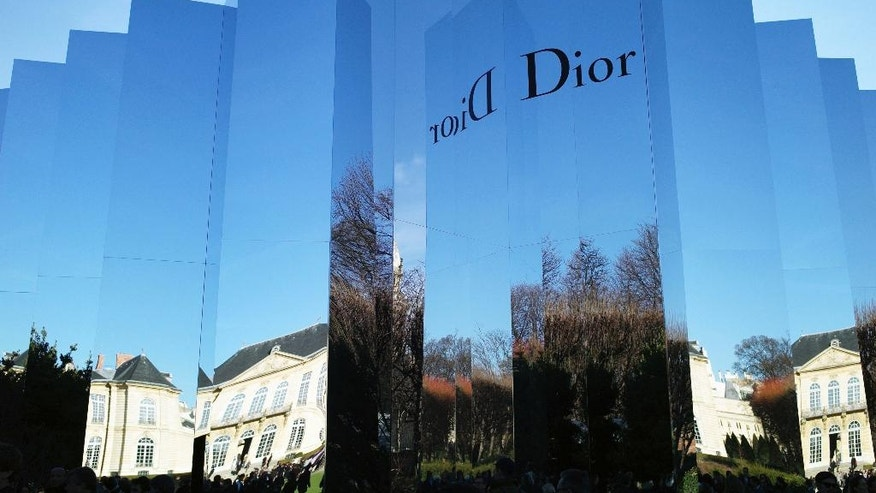 FILE - In this Jan.25, 2016 file photo, the Rodin museum, venue for Christian Dior's Spring- Summer 2016 Haute Couture fashion collection, is reflected in Paris. The magnate behind the LVMH luxury empire is seeking to strengthen control over Christian Dior in a multibillion-dollar deal combining the fashion industry heavyweights. (AP Photo/Thibault Camus, File)