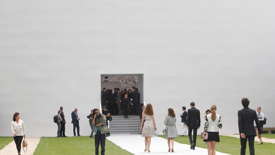 FILE - In this July 7, 2014 file photo, guests arrive to attend Dior's Fall-Winter 2014-2015 Haute Couture fashion collection, in Paris. The magnate behind the LVMH luxury empire is seeking to strengthen control over Christian Dior in a multibillion-dollar deal combining the fashion industry heavyweights. AP Photo/Thibault Camus, File)