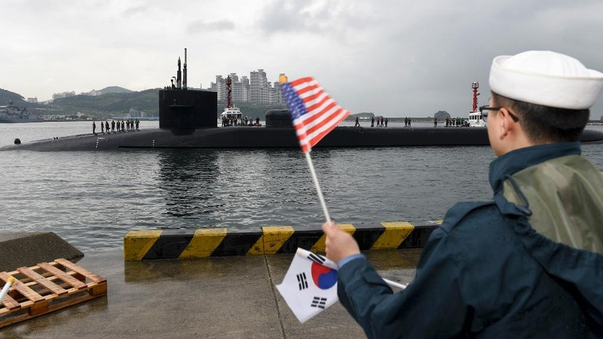 In this Monday, April 24, 2017 photo released by the U.S. Navy, the Ohio-class guided-missile submarine USS Michigan is greeted as it arrives in Busan, South Korea, for a scheduled port visit while conducting routine patrols throughout the western Pacific. (Mass Communication Specialist 2nd Class Jermaine Ralliford/U.S. Navy via AP)