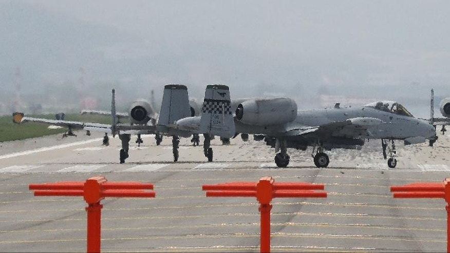 U.S. Air Force's A-10 attack aircrafts prepare to take off at Osan Air Base in Pyeongtaek, South Korea, Tuesday, April 25, 2017. South Korea's military said Tuesday that North Korea held major live-fire drills in an area around its eastern coastal town of Wonsan as it marked the anniversary of the founding of its military. (Hong Hae-in/Yonhap via AP)