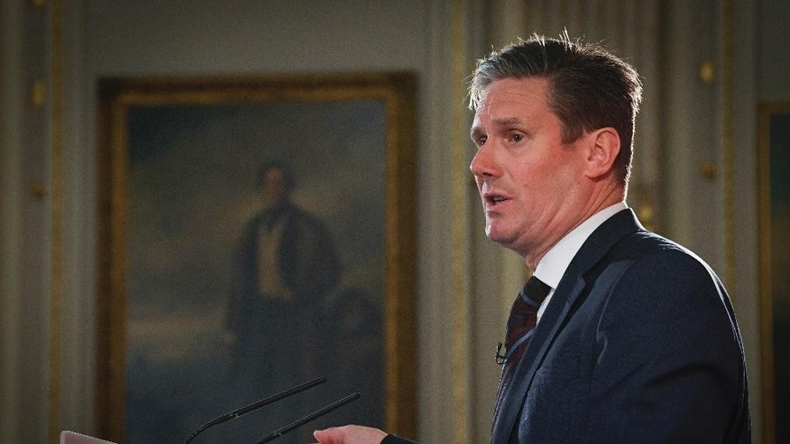 "Labour Party Brexit spokesman Keir Starmer, makes a speech outlining Labour's approach to Brexit in central London, Tuesday April 25, 2017. The left-of-center party promised Tuesday that if it wins it will guarantee European Union nationals they can stay in Britain, and accused the Conservative government of ""rigidity and recklessness"" in its approach to the U.K.'s EU divorce. (Stefan Rousseau/PA via AP)"
