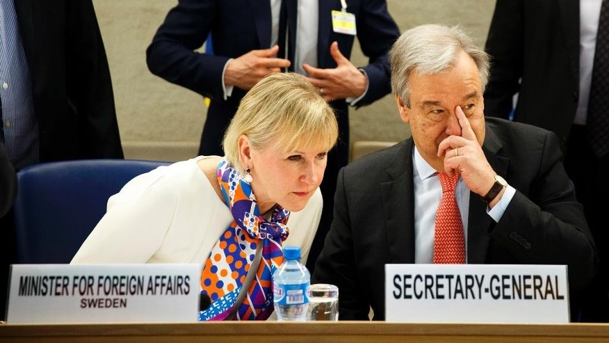 Swedish Foreign Minister Margot Wallstrom, left, talks with U.N. Secretary-General Antonio Guterres after arriving at the high-level pledging event for the humanitarian crisis in Yemen at the European headquarters of the United Nations in Geneva, Tuesday April 25, 2017. (Valentin Flauraud/Keystone via AP)