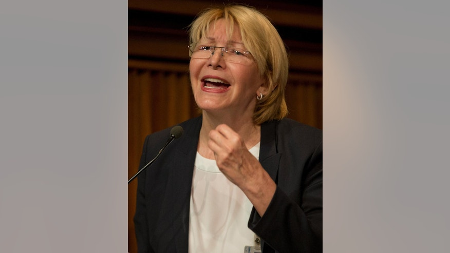 Venezuela's General Prosecutor Luisa Ortega Diaz speaks during a news conference at her office in Caracas, Venezuela, Tuesday, April 25, 2017. Four more people have died in protests against Venezuela's President Nicolas Maduro, the government said Monday, bringing the total death toll in recent protests and unrest in the country to 26. (APPhoto/Ariana Cubillos)