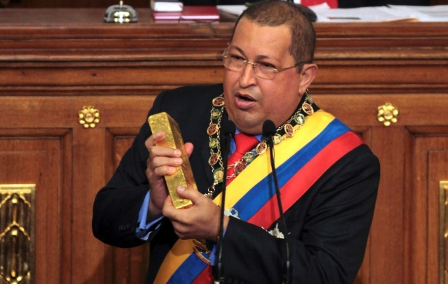 "Venezuela's President Hugo Chavez holds a gold bar as he gives his annual address to the National Assembly in Caracas, Venezuela, Friday Jan. 13, 2012.  Chavez defended government policies, including his recent decision to withdraw billions of dollars in its gold reserves from U.S. and European banks and bring it back to the Central Bank in Caracas. Holding a bar of gold, he criticized prior governments, saying: ""They had taken our gold away.""  (AP Photo/Fernando Llano)"